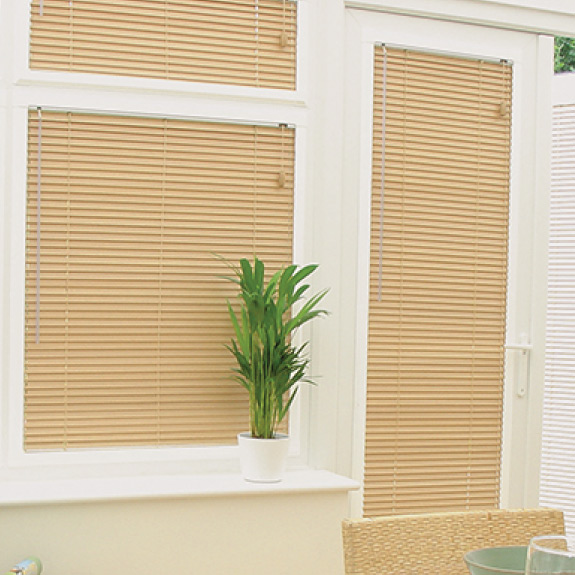 Venetian blinds made from light coloured wood