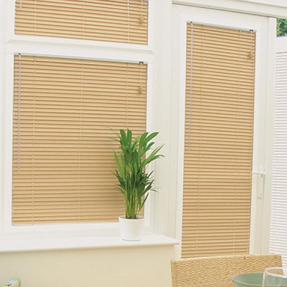 Venetian blinds made from light coloured wood
