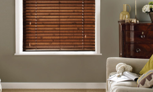 Venetian blinds made from a dark wood